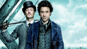 Robert Downing Jr. and Jude Law. Photo from the film Sherlock Holmes (2009), directed by Guy Ritchie and produced by Warner Bros. and others. This work is in copyright. Source: Wem Town Hall